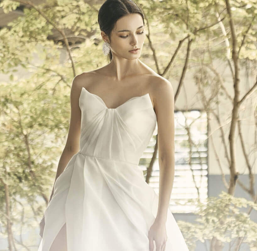 Model wearing a white simple bridal gown