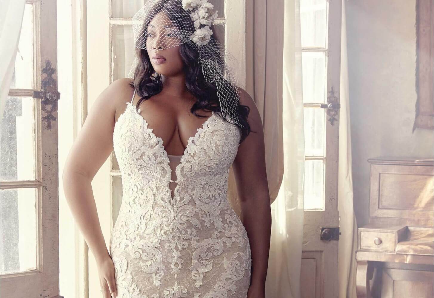 Plus size model wearing a white bridal gown